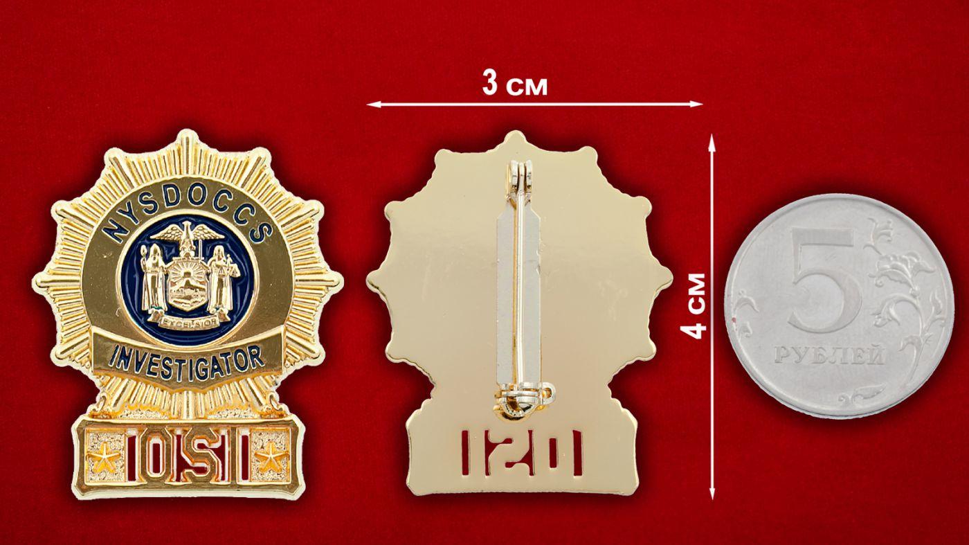 Значок Департамента исправительных учреждений штата Нью-Йорк - сравнительный размер
