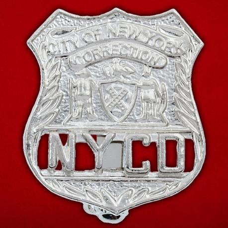 Значок Департамента по надзору за заключенными города Нью-Йорка
