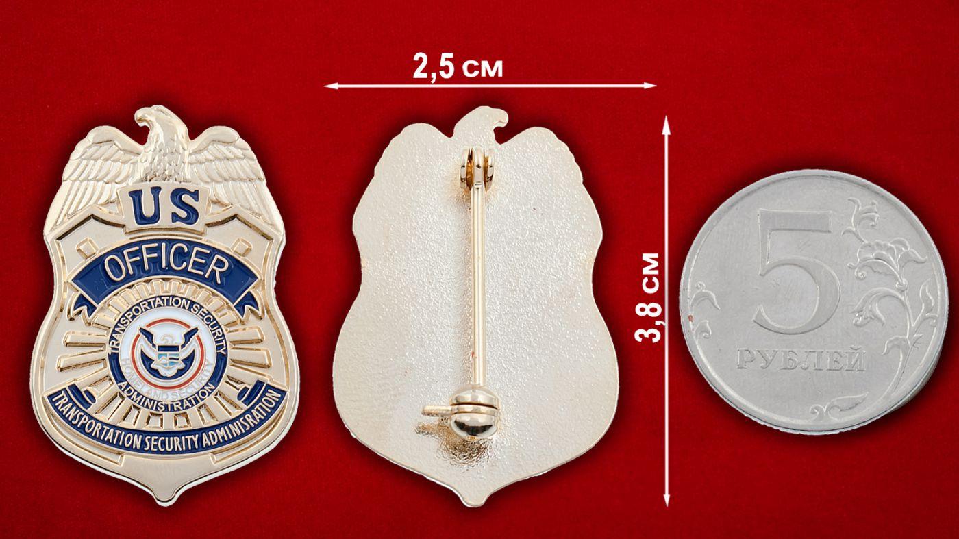 Значок офицера Управления транспортной безопасности США - сравнительный размер