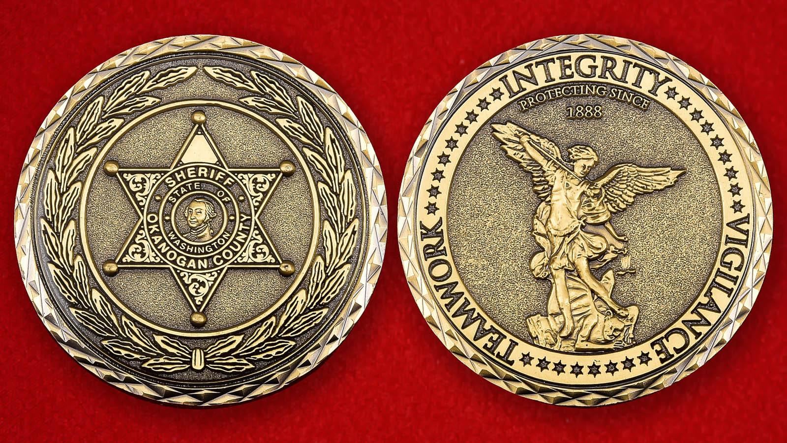 """Американская монета """"Шериф округа Оканоган"""""""