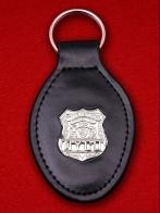 """Брелок с жетоном """"Департамент исполнения наказаний города Нью-Йорка"""""""