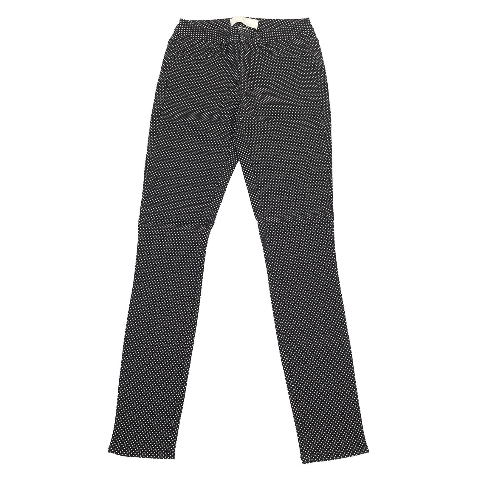 Черные женские брюки Pieces в мелкий белый горошек.