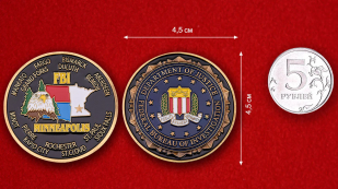 Challenge coin of the Department of Justice FBI in Minneapolis - comparative size