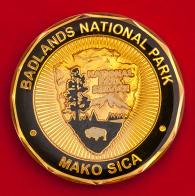 """Челлендж коин """"Национальный парк Бэдлендс, Южная Дакота"""" Министерства природных ресурсов США"""