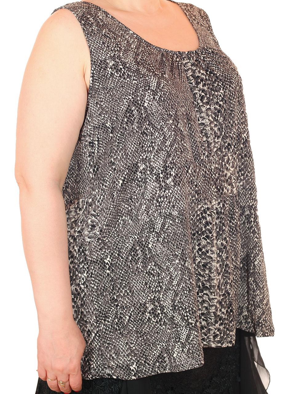 Фактурная женская блуза – свободный фасон без застежек и ворота