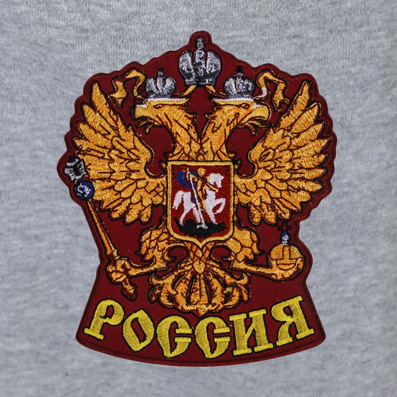"""Фирменные спортивные штаны с нашивкой """"Герб России""""."""