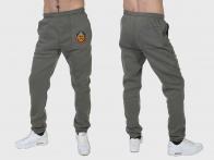 Фирменные утепленные спортивные штаны УГРО