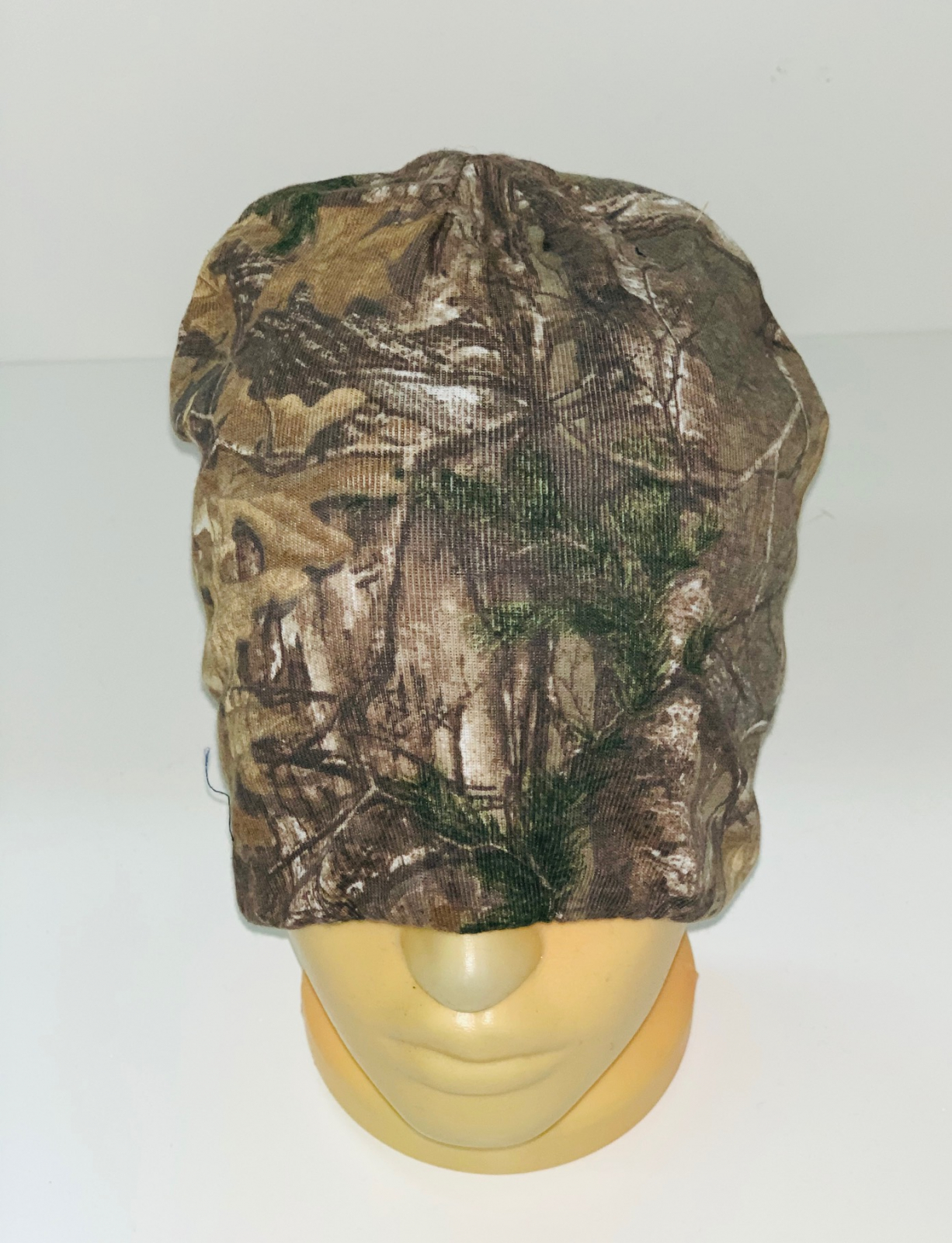 Камуфлированная крутая шапка