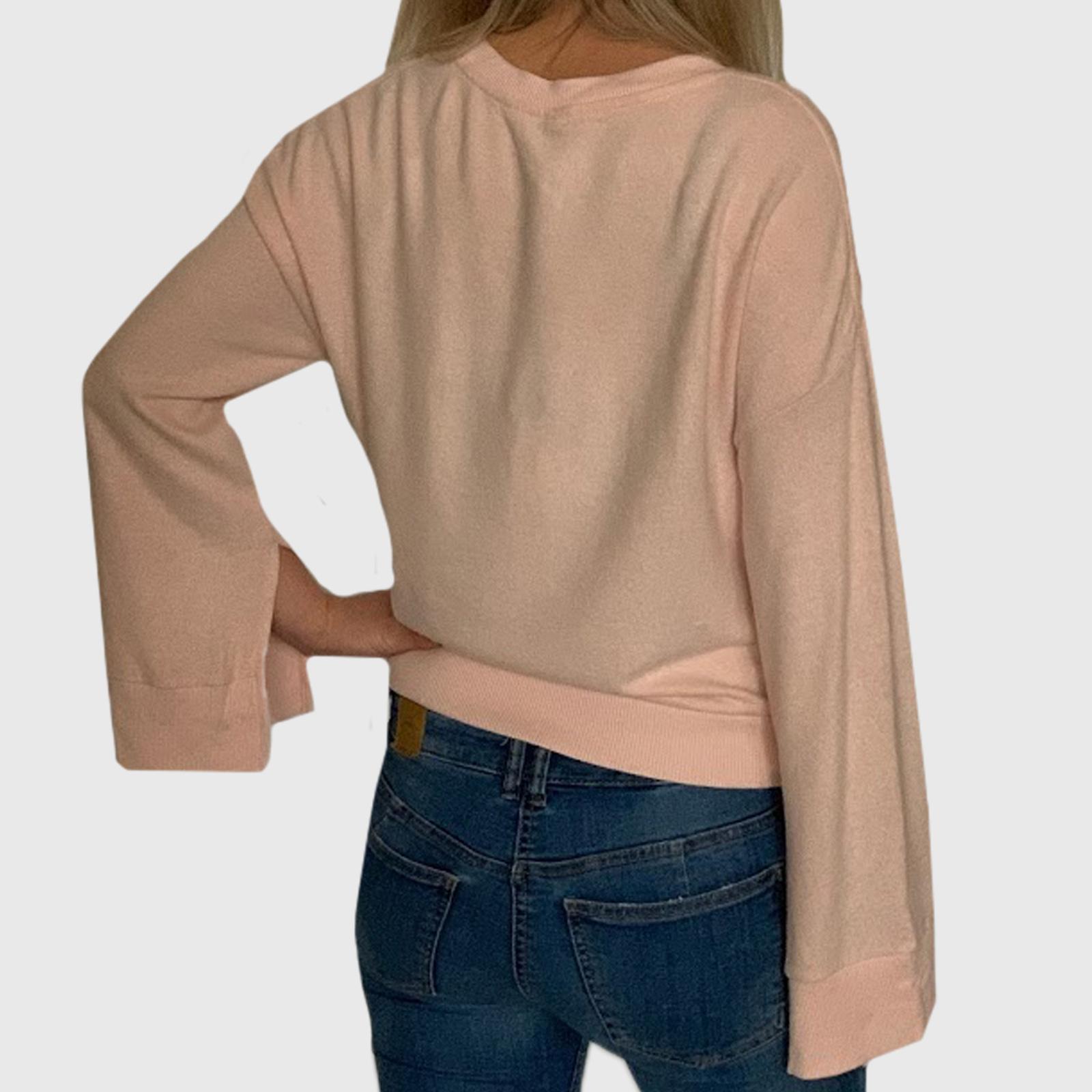 Недорогая женская кофточка в розовом цвете