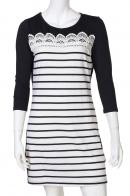 Красивое черно-белое платье с ажурной вставкой