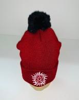 Красная шапка с вышивкой и черным помпоном