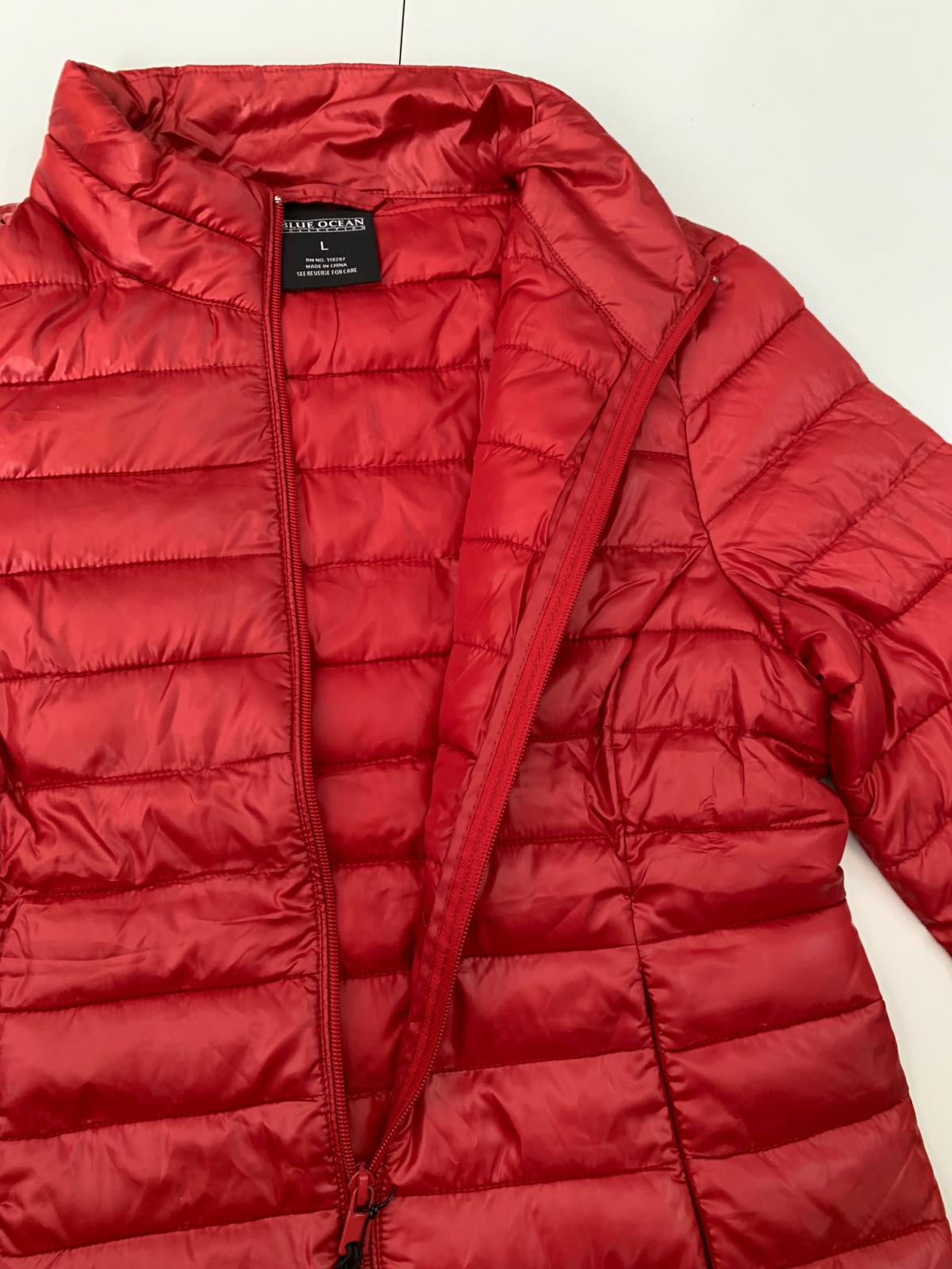Красная женская куртка от бренда BLUE OCEAN