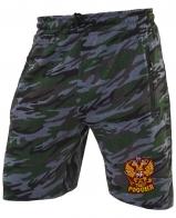 Крутые шорты удлиненного фасона с карманами и нашивкой Россия