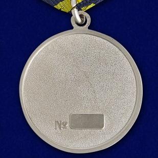 """Латунная медаль """"Ветеран дальней авиации"""" (в футляре) - обратная сторона"""