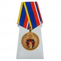 Медаль 100 лет Службе тыла МВД России на подставке