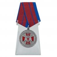 Медаль 210 лет войскам Национальной Гвардии на подставке