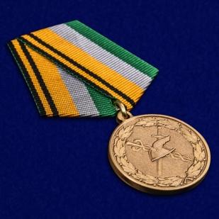 Медаль МО РФ 100 лет военной торговле - общий вид