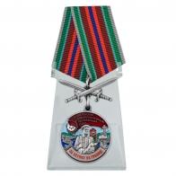 Медаль За службу в 74 Сретенском погранотряде с мечами на подставке