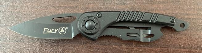 Небольшой складной нож темного цвета
