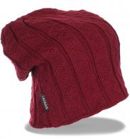 Новомодная зимняя женская шапка супермодного дизайна утепленная флисом с напуском назад