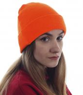 Оранжевая женская шапочка. Удачная модель для спорта и активного отдыха