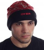 Оригинальная теплая шапка с отворотом и спортивным орнаментом