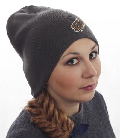 Популярная женская шапка с эффектной аппликацией. Незаменима для прогулок в холодную погоду. Заказывайте!