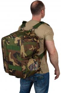 Практичная дорожная сумка-рюкзак с шевроном Охотничьего спецназа купить в розницу