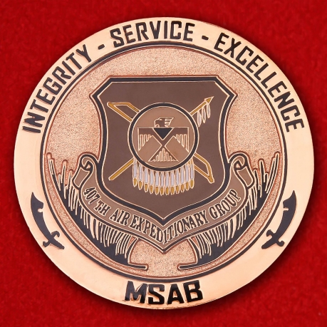 Presented for excellence by the 497th AEG Chief Challenge Coin