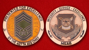 Presented for excellence by the 497th AEG Chief Challenge Coin - obverse and reverse