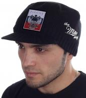 Новинка этой зимы! Мужская шапка Miller Way с патриотической нашивкой – Двуглавый орел на фоне флага России. Почувствуй себя комфортно и по-настоящему уверенно