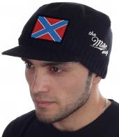 Мужская шапка Miller Way с козырьком и нашивкой в виде флага Новороссии. Фасон осень-зима плотно облегает голову, закрывает уши, защищает глаза от ветра и осадков