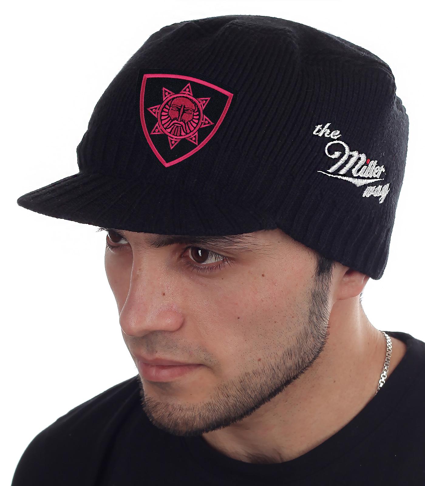 Мужская шапочка Miller Way с символом славянского Бога Сварога. Фасон милитари сочетается с куртками, пуховиками и дублёнками. Будь стильным при любой погоде