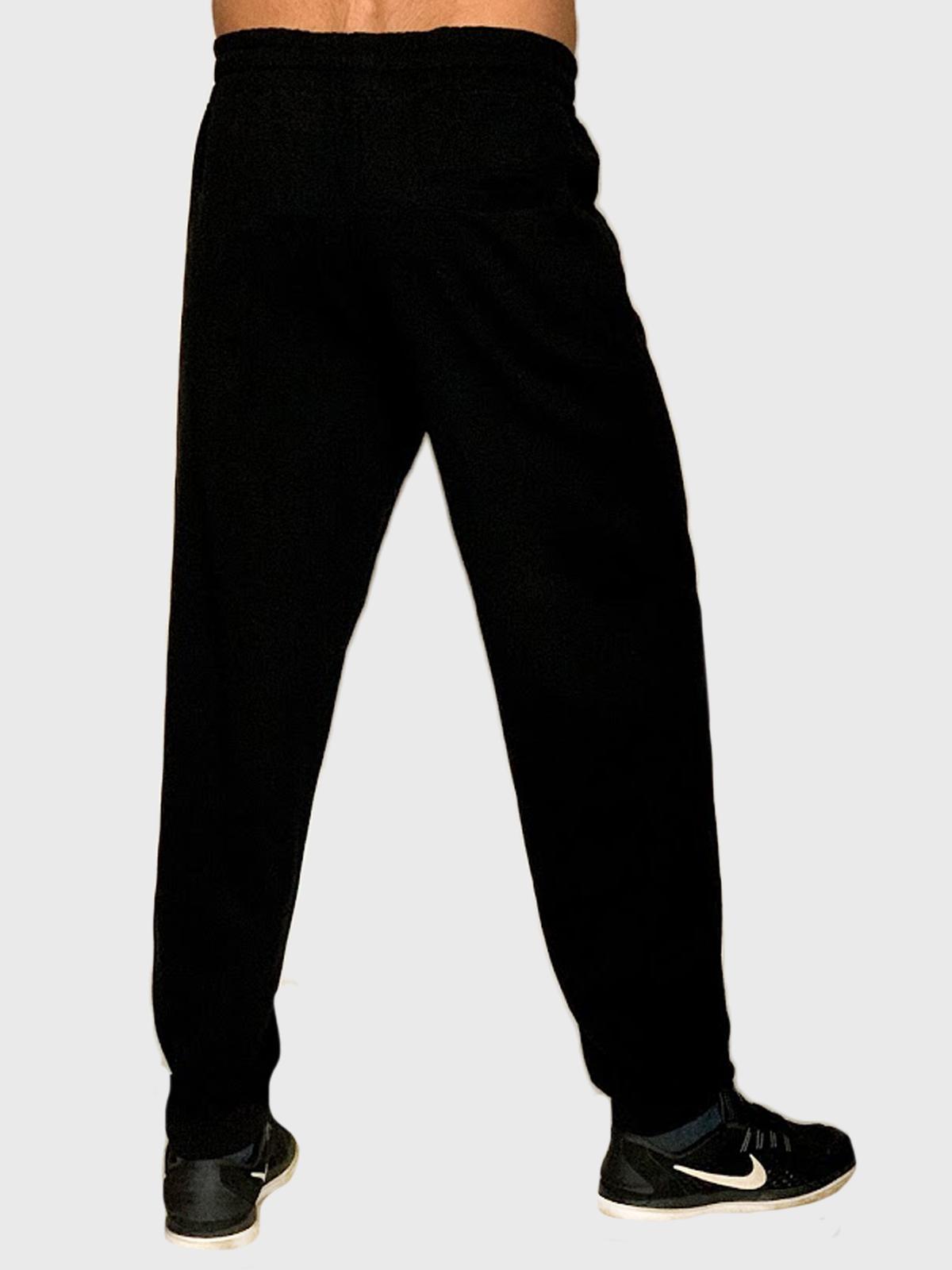 Недорого купить мужские штаны черного цвета с манжетами