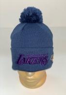 Синяя шапка с помпоном и фиолетовой вышивкой