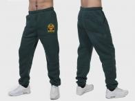 Зеленые спортивные штаны с гербом СССР