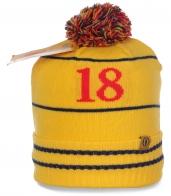 Желтая женская шапка для занятий спортом актуальная комфортная уютная и модная