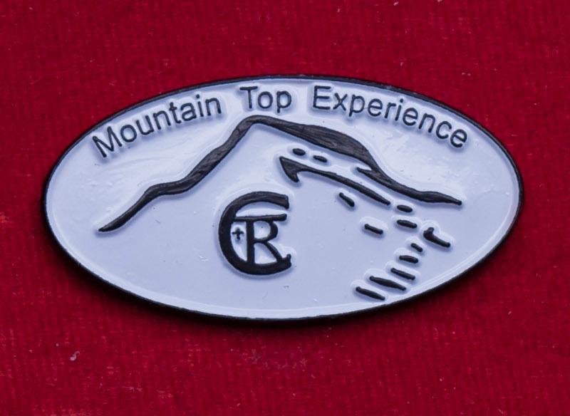Значок туристической компании Mountain Top Experience, Австралия