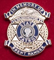 """Значок """"В память об эксперте-криминалисте штата Вашингтон Бренте Хенджере"""""""